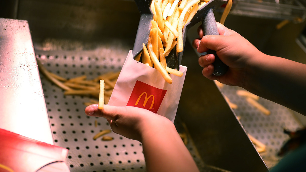 McDonald's employee bags up fries