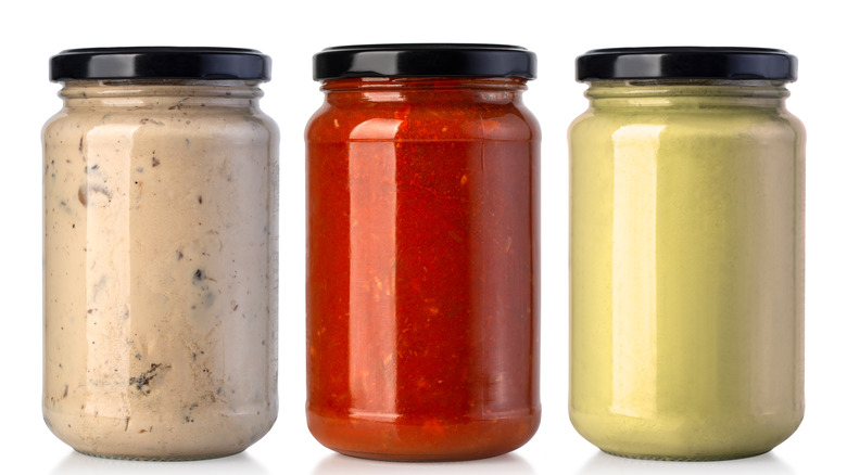 A row of sauce jars