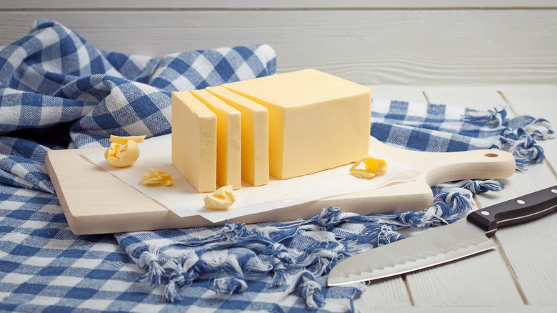 Chopped butter on a blue and white gingham napkin