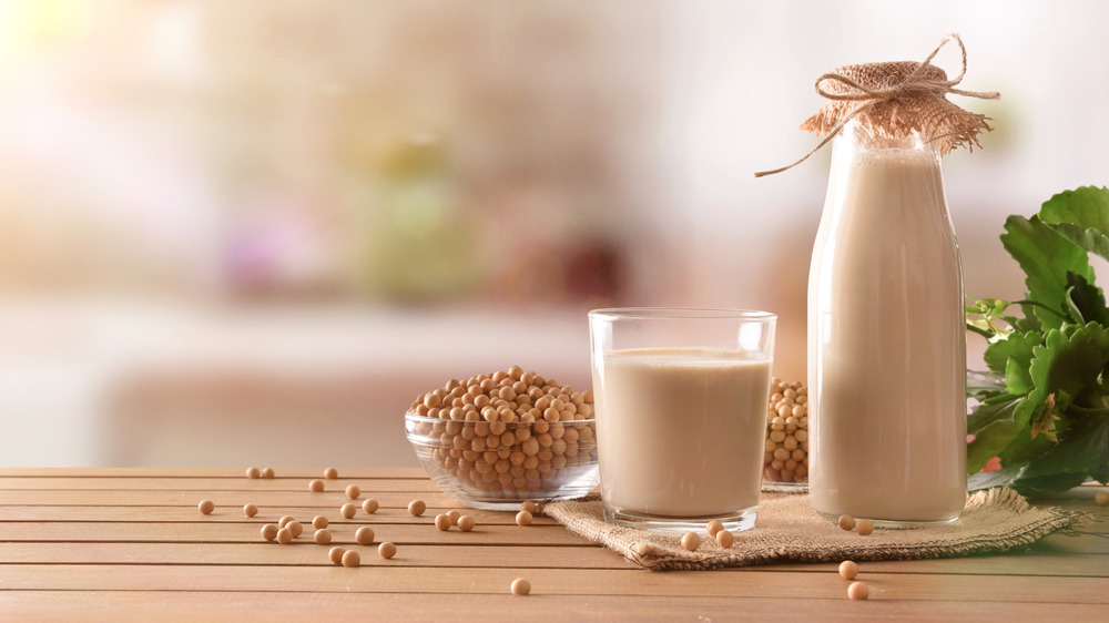 Soy milk in a cup and jug