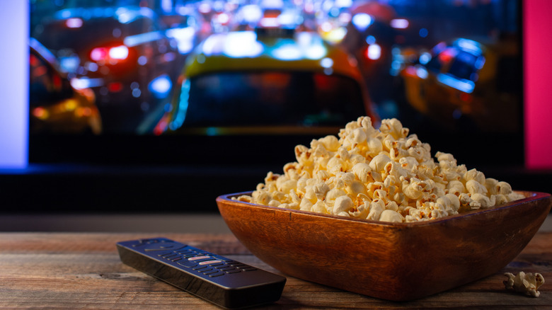 Home movie on TV with popcorn