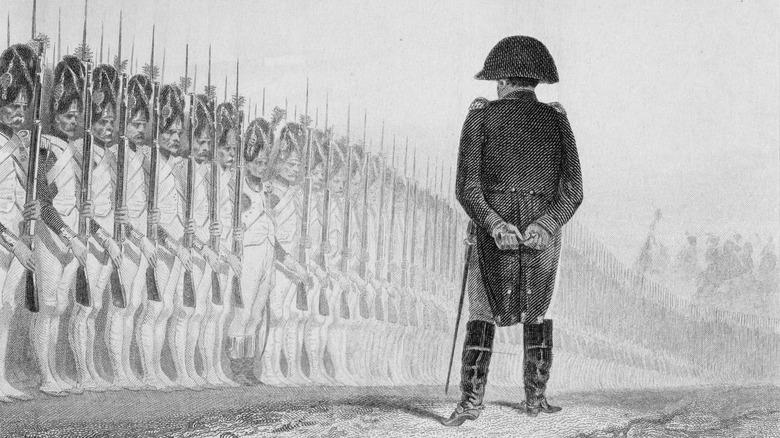 Napoleon Bonaparte reviews his troops.