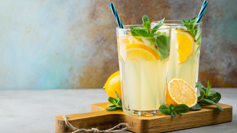 Two glasses of lemonade with straws