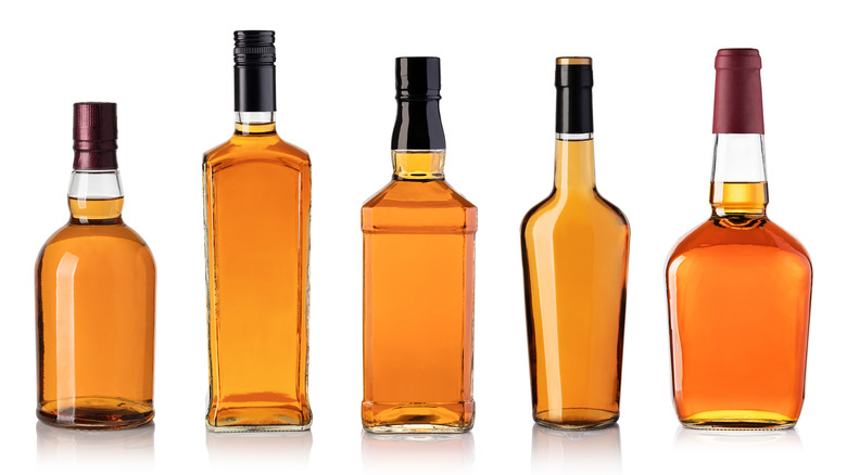 Bottles of bourbon/whiskey with no labels
