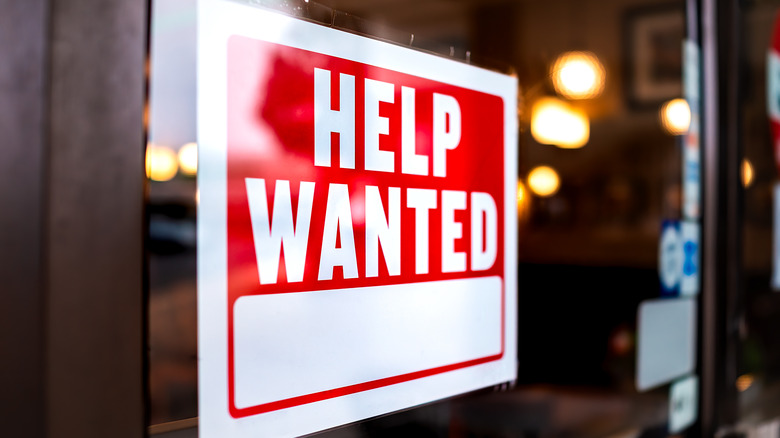 Help wanted sign on a window