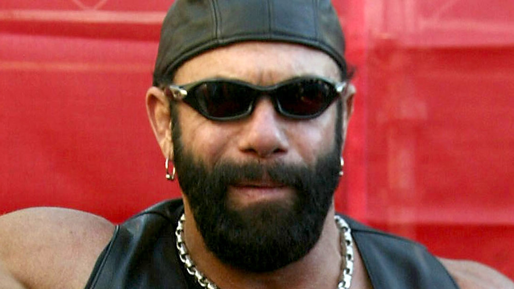 Randy Savage poses at event