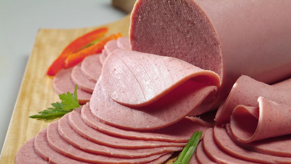 sliced bologna on a cutting board