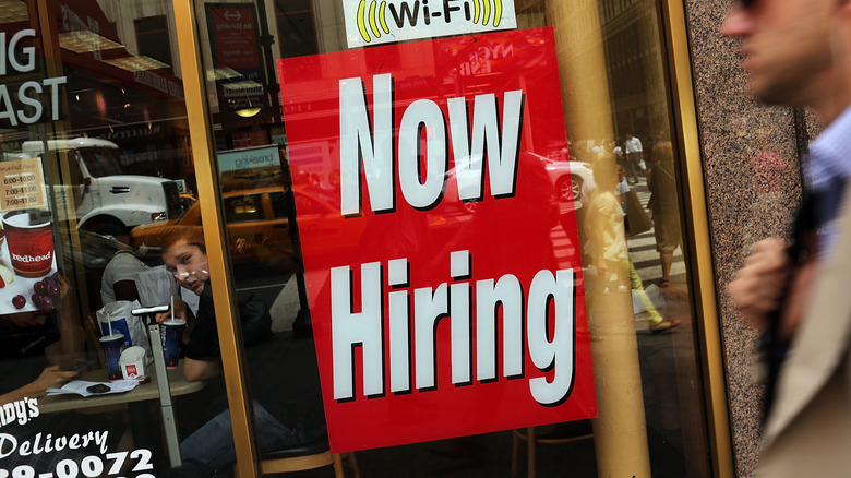 """""""Now hiring"""" sign at restaurant"""