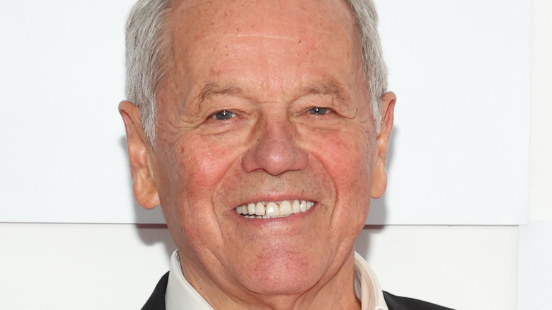 Wolfgang Puck smiling at event