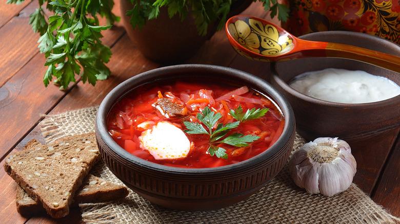 Borscht with garlic and spoon