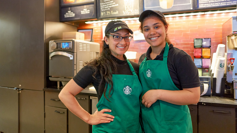 Starbucks baristas in green aprons