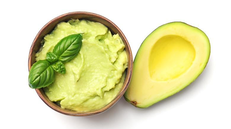 Guacamole and a cut avocado