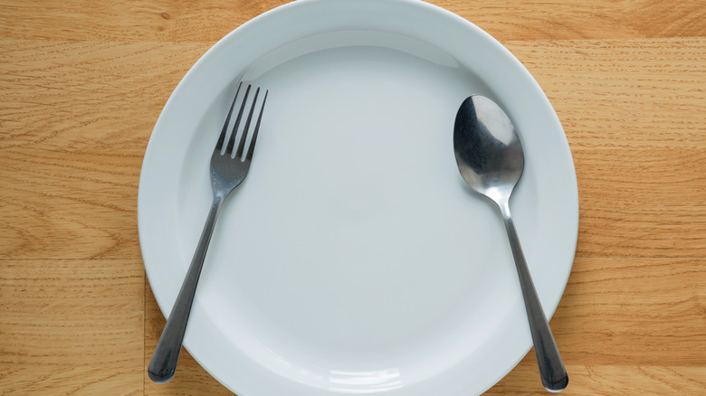 Fork and spoon on a white plate