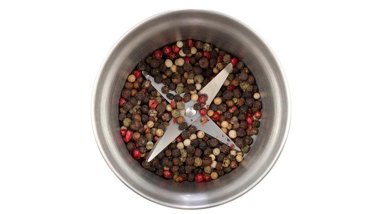 peppercorn mix in electric spice grinder