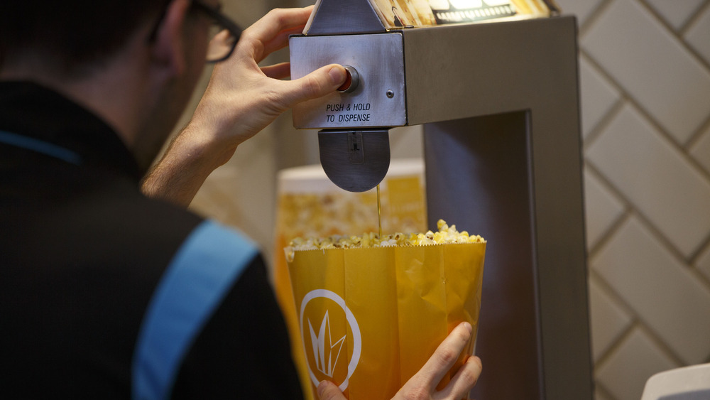 Person buttering popcorn