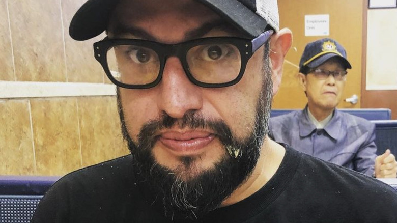 carl Ruiz eating at a restaurant