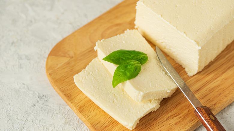 Knife next to sliced tofu