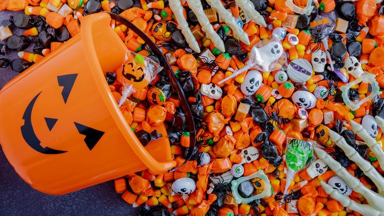 Orange Halloween basket with candy