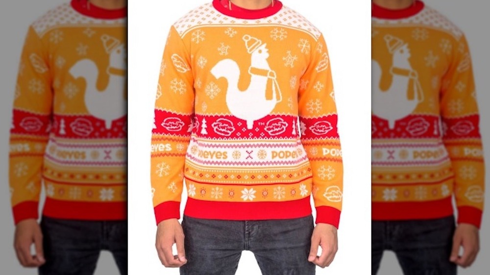 Man wearing Popeyes ugly Christmas sweater