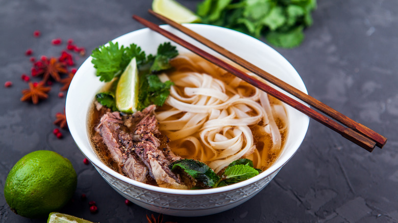 Bowl of beef pho with chopsticks