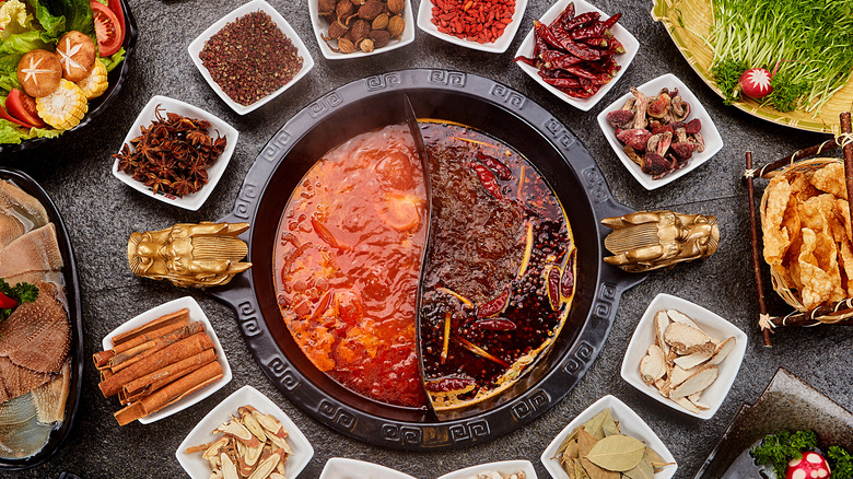 Chinese hot pot surrounded by ingredients