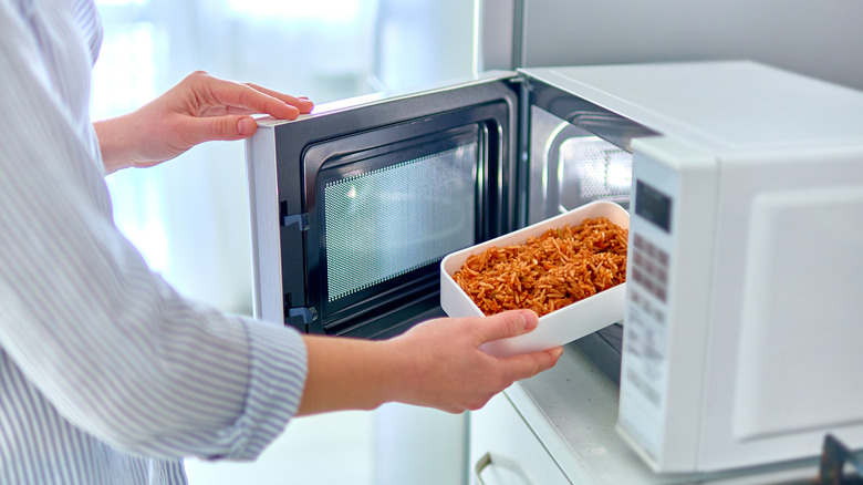 Putting container of food in microwave