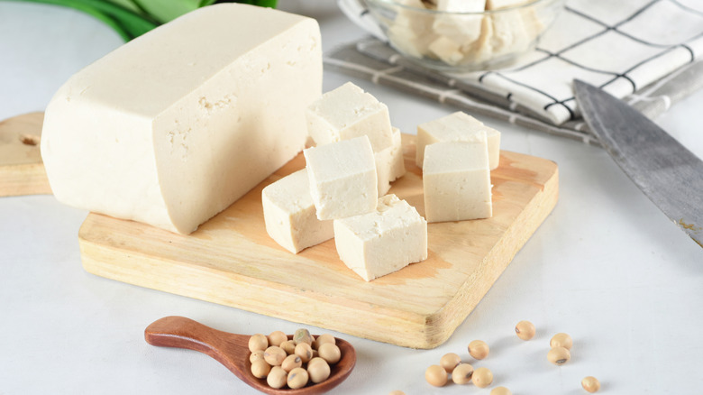 Tofu on wooden cutting board