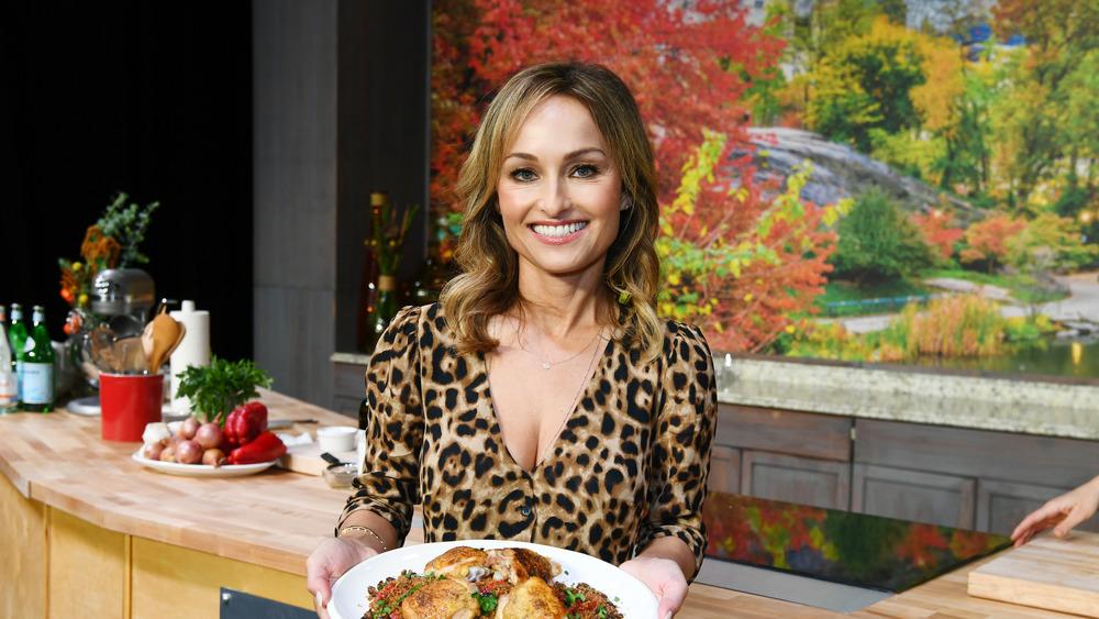 Giada De Laurentiis holding a plate of food