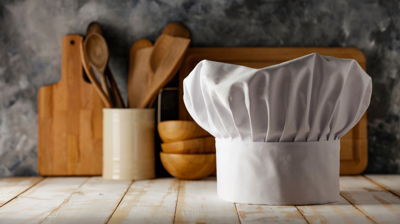 Chef hat with wooden utensils