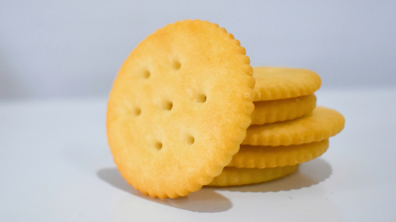 Stack of Ritz crackers against a white background