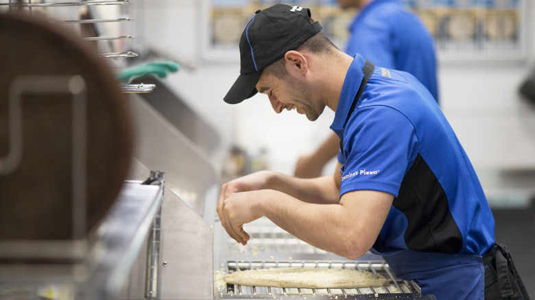 An employee at a Domino's