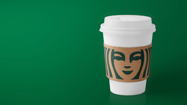 Starbucks cup on green background