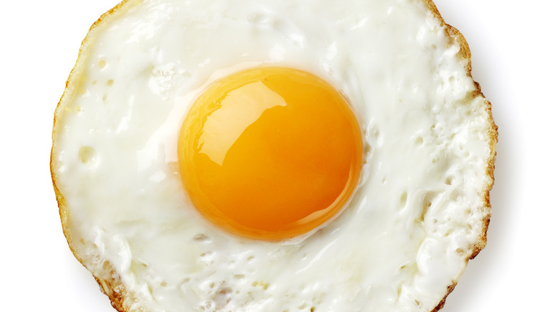 Perfectly circular fried egg on white background