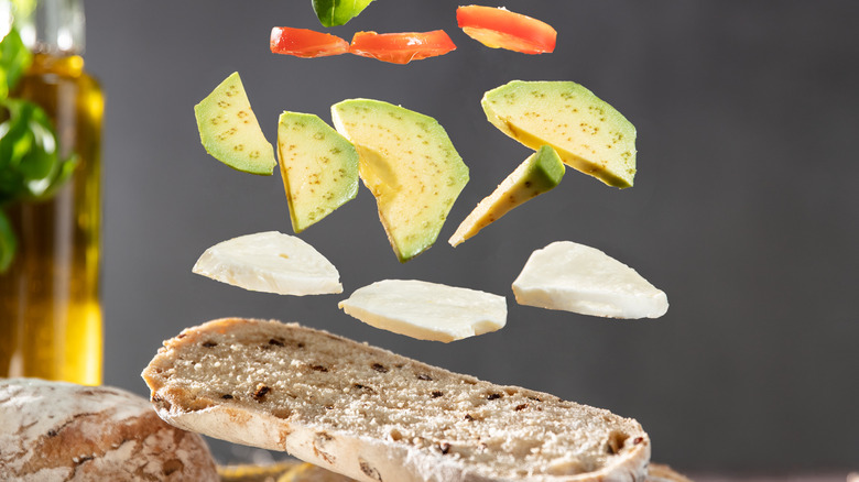 Ingredients falling onto slice of bread