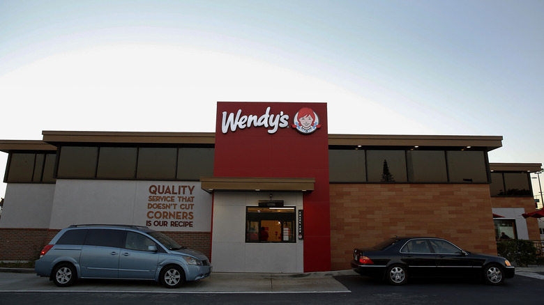 Wendy's drive-thru with cars