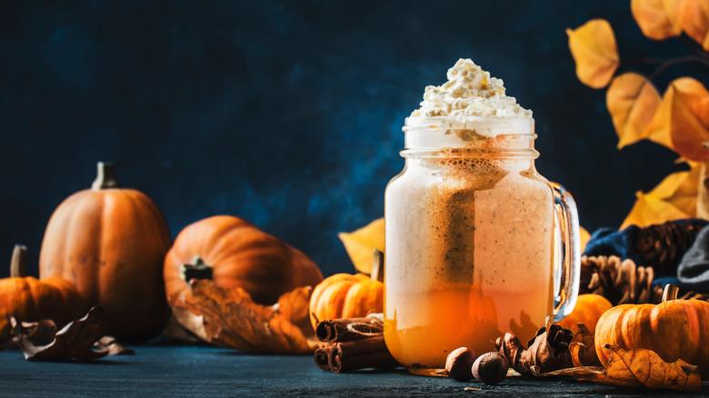 Pumpkin spice beverage with pumpkins
