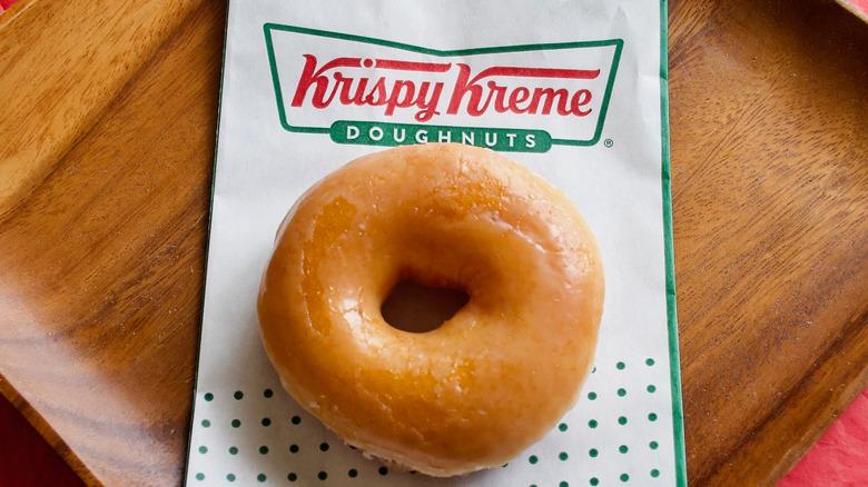Donut on a Krispy Kreme bag