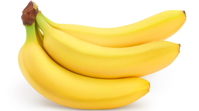Yellow bananas on white background