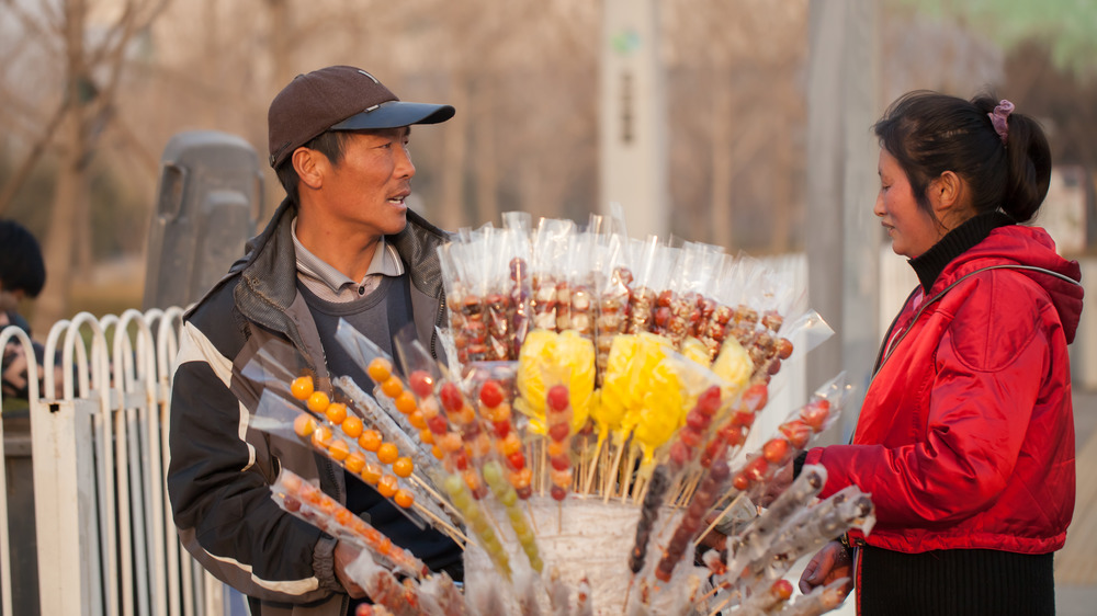Beijing street vendor selling candied fruit