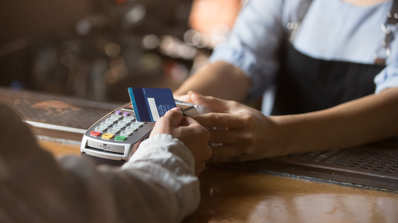 customer paying with debit card