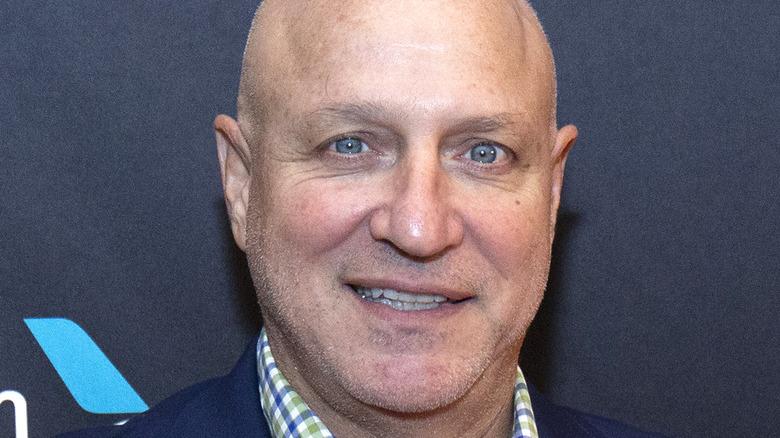 Tom Colicchio smiling unevenly