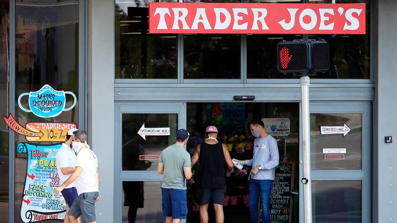 Trader Joes employee distributes hand sanitizer