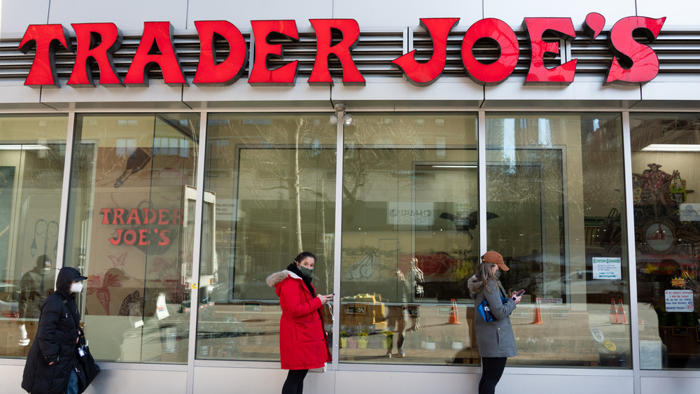 People outside Trader Joe's store exterior
