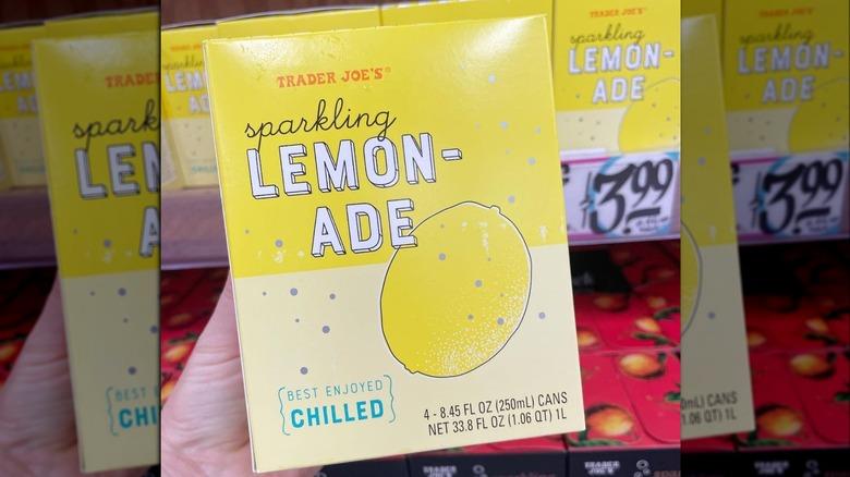 Hand holding Trader Joe's Sparkling Lemonade