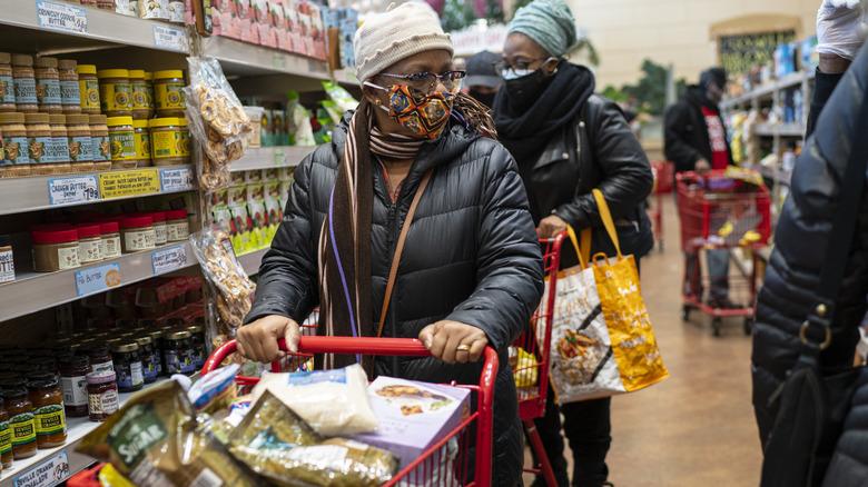 Masked woman in Trader Joe's