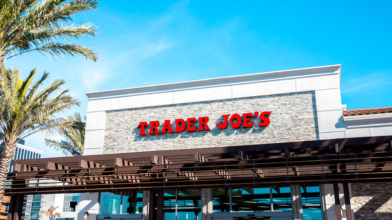 Exterior of Trader Joe's building with palm trees