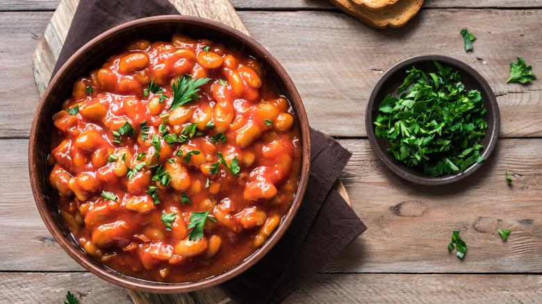 Bowl of chili, blue bowl, Scallions