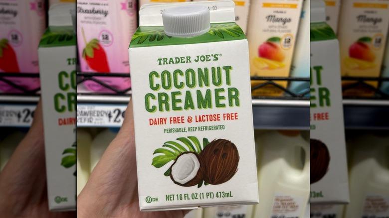 Hand holding Trader Joe's Coconut Creamer