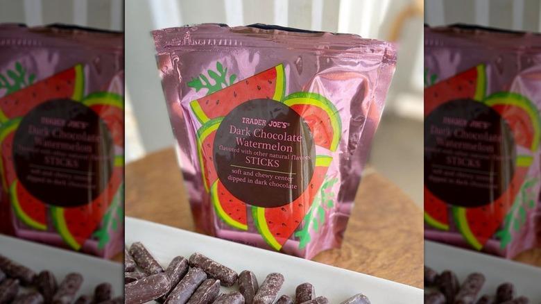 Bag of Trader Joe's Dark Chocolate Watermelon Sticks with Sticks on plate