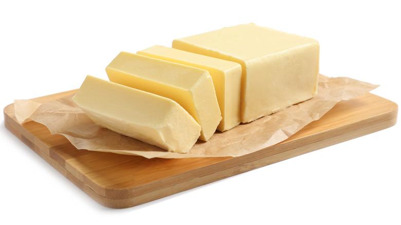 Chopped blocks of butter on wooden board